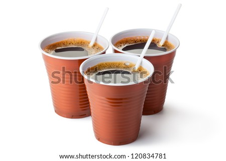 Three plastic vending cups filled with coffee. Isolated on a white.