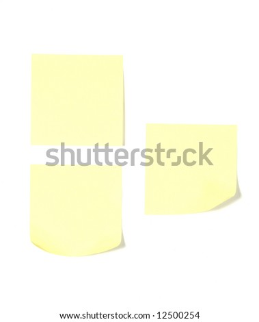 Three post its on a desk in an office isolated on white