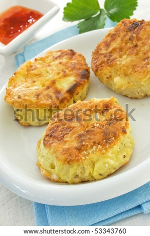 Three potato cakes on a white plate