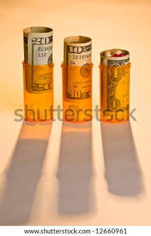 Three prescription pill bottles with pills and money, warm back light and long shadows