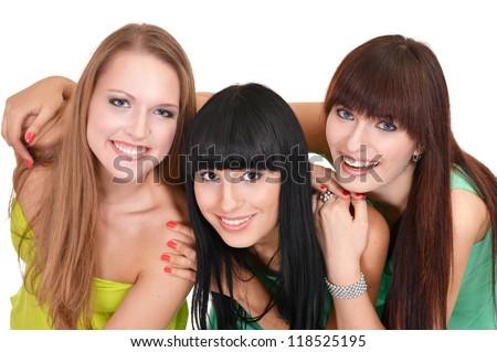 three pretty girls posing on a white background