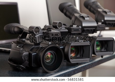 three professional digital video cameras