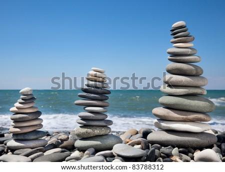Three pyramids of stones for meditation lying on seacoast