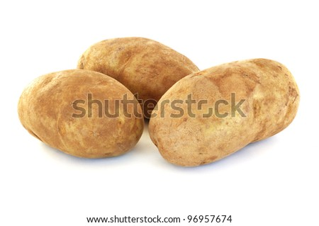 Three Raw Russet Potatoes Isolated on White