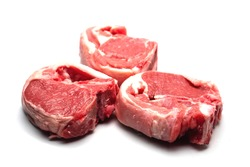 Three raw uncooked lamb loin chops on a white background, isolated, Meat industry product