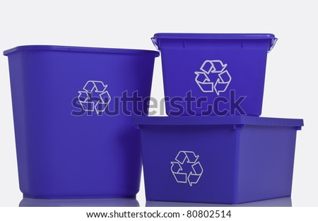 Three recycling blue bins isolated on white background.