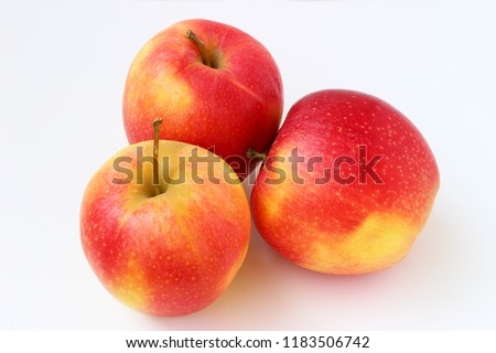 Three red apples on a white background #1183506742