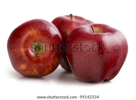 Three red apples on the white background