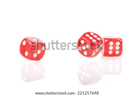 Three red bouncing dice isolated on white background with reflection #221257648