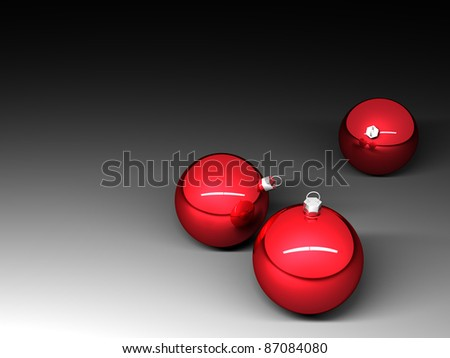 Three red christmas balls on dark background - stock photo