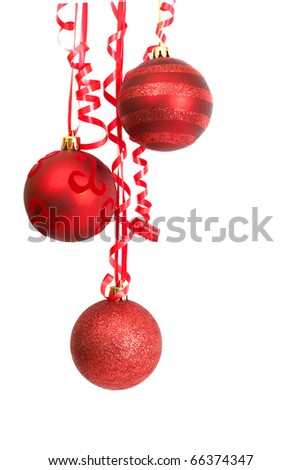 Three red Christmas baubles hanging on a ribbon isolated on white background with copy space.