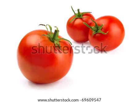 Three red fresh ripened  tomatoes isolated on white