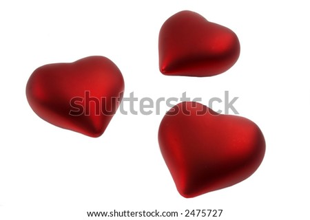 Three red hearts isolated over a white background