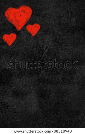Three red hearts on black background