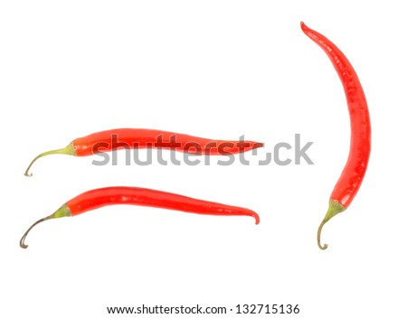 Three red hot chilli, or chili, peppers isolated on a white background used in cooking as a pungent seasoning and flavouring and as a dried spice