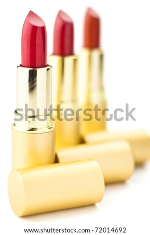 three red lipsticks with shallow depth of field