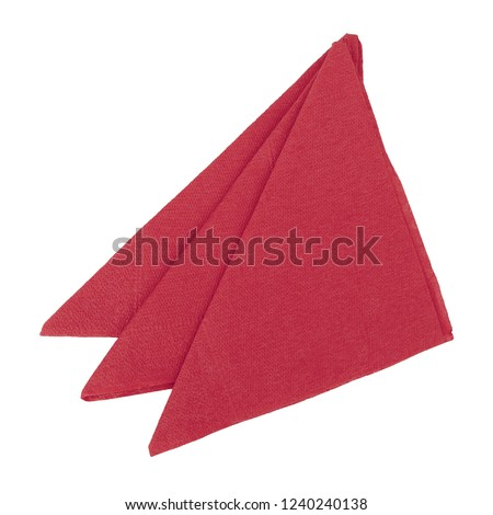 Three red paper napkins, serviettes folded to triangles and isolated on white background