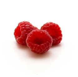 Three red raspberries isolated on white background