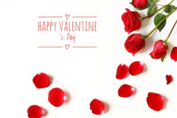 Three red roses and some red roses petals, and text happy valentine 's day, isolated on white
