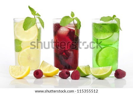 Three refreshing drinks in glasses with mint and ice isolated