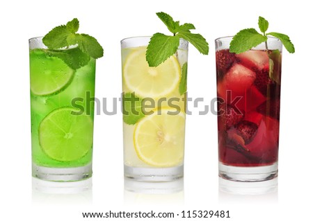 Three refreshment drinks in glasses with mint and ice isolated - stock photo
