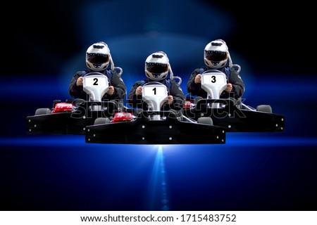Three riders Go kart speed rive indoor racing on a blue background. Go kart indoor, cart racing fast, car where gokarting, we speed racing, racers banner Copy space. Photo stock ©