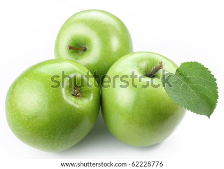Three ripe green apples isolated on a white.