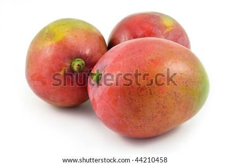 Three ripe mangoes isolated on white background - stock photo