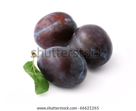 Three ripe plums isolated on white background