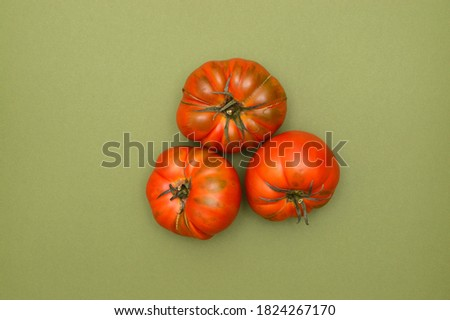 Three Ripe Raf Tomatoes on green background Zdjęcia stock ©