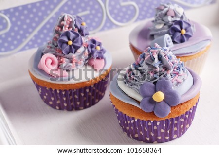 three romantic wedding cupcakes on a plate