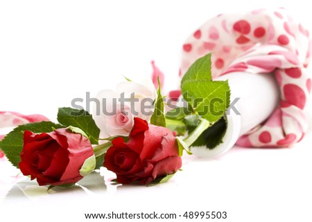 Three roses on the ground in a vase isolated over white