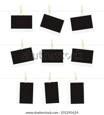 Three rows of three blank pieces of instant film hanging from clothespins on strings isolated on white.
