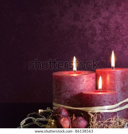 Three scented candles in purple for the christmas period