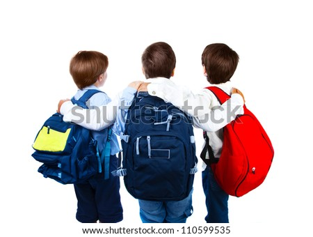 Three schoolboys isolated on white background, rear view of three teenager with colorful backpacks, best friends standing and hugs in studio, back to school, education concept