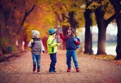 three schoolboys walking on the street
