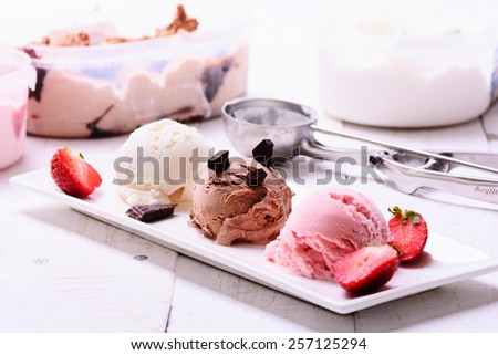 three scoops of ice cream chocolate vanilla strawberry