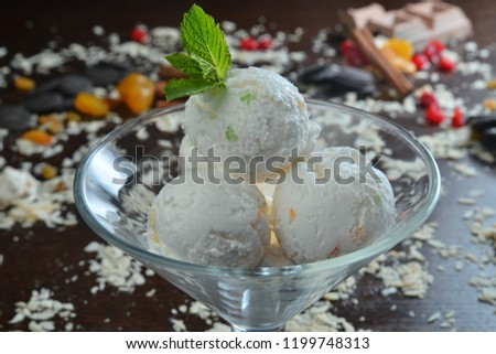 three scoops of ice cream decorated with mint closeup