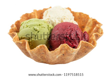 Three scoops of natural organic fruit ice cream in a wafer cup isolated on white. Home made dessert