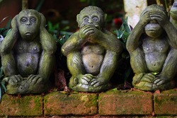 Three sculptures of monkeys: not to see evil, not to speak evil, not to hear evil. Thailand