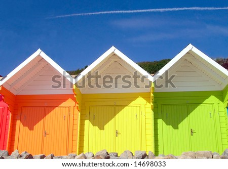 Three seaside beach chalets, Scarborough, England.