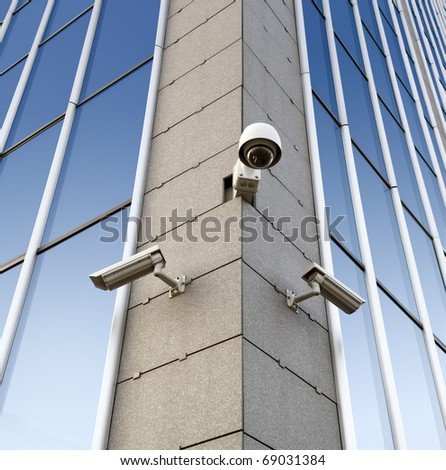 Three security cameras attached on the office building corner
