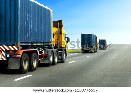 Three Semi Truck on highway road with blue container, transportation concept,import,export logistic industrial Transporting Land transport on the asphalt expressway with blue sky #1150776557