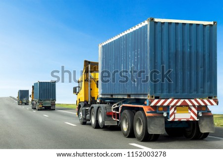 Three Semi Truck on highway road with blue container, transportation concept,import,export logistic industrial Transporting Land transport on the asphalt expressway with blue sky #1152003278
