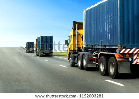 Three Semi Truck on highway road with blue container, transportation concept,import,export logistic industrial Transporting Land transport on the asphalt expressway with blue sky #1152003281