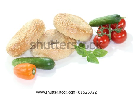 three sesame bagel with vegetables on white background