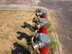 Three sets of red fire hydrants On the ground background and cement floor With copy space.
