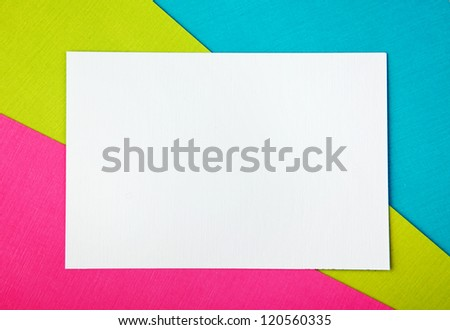 three sheets of colored paper with a clean sheet of white paper