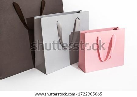 three shopping bags black grey pink Foto stock ©