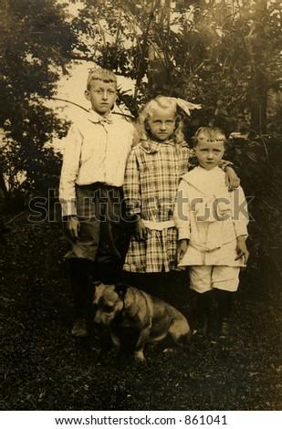 three siblings in a vintage...